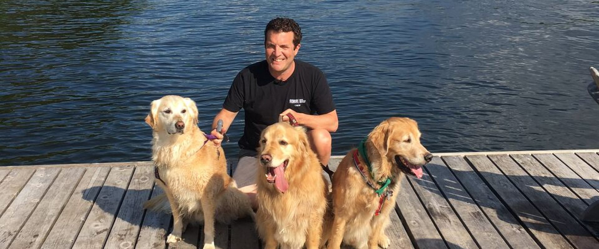 Rick Mercer with Goldens by the water