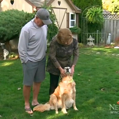 Couple with Golden Retreiver